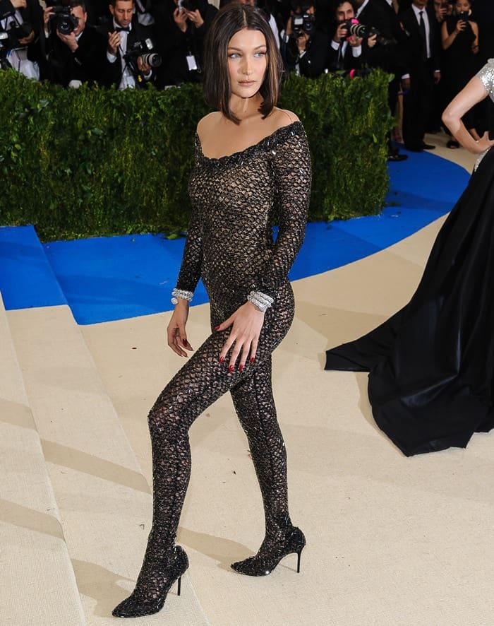 Bella Hadid styled the glittery number with black stiletto heels and a snake cuff on each arm