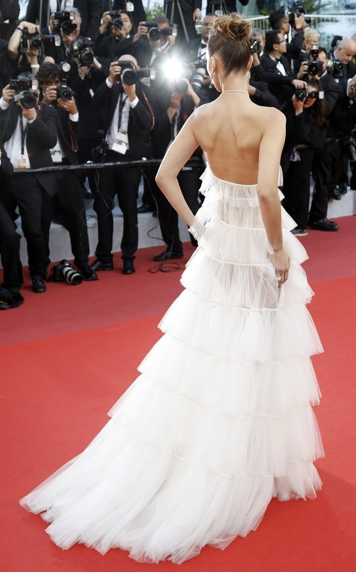 Bella Hadid rocked a swept-up messy bun in a white Christian Dior Couture gown