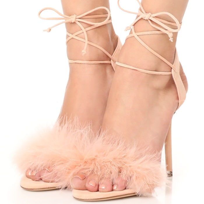 This nude-pink suede version is embellished with a tactile ostrich feather across the toes and the ankle is secured with wraparound ankle straps