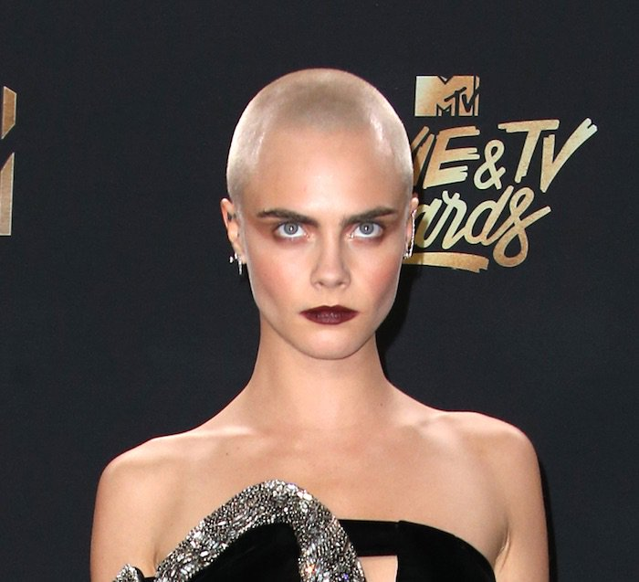 Cara Delevingne in head-to-toe Saint Laurent for the MTV Movie & TV Awards on May 7, 2017 at the Shrine Auditorium in Los Angeles