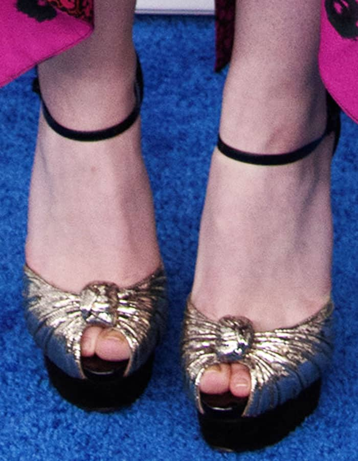"Dakota inserts a little shine into her look with a pair of Christian Louboutin ""Marchavekel"" platform sandals"