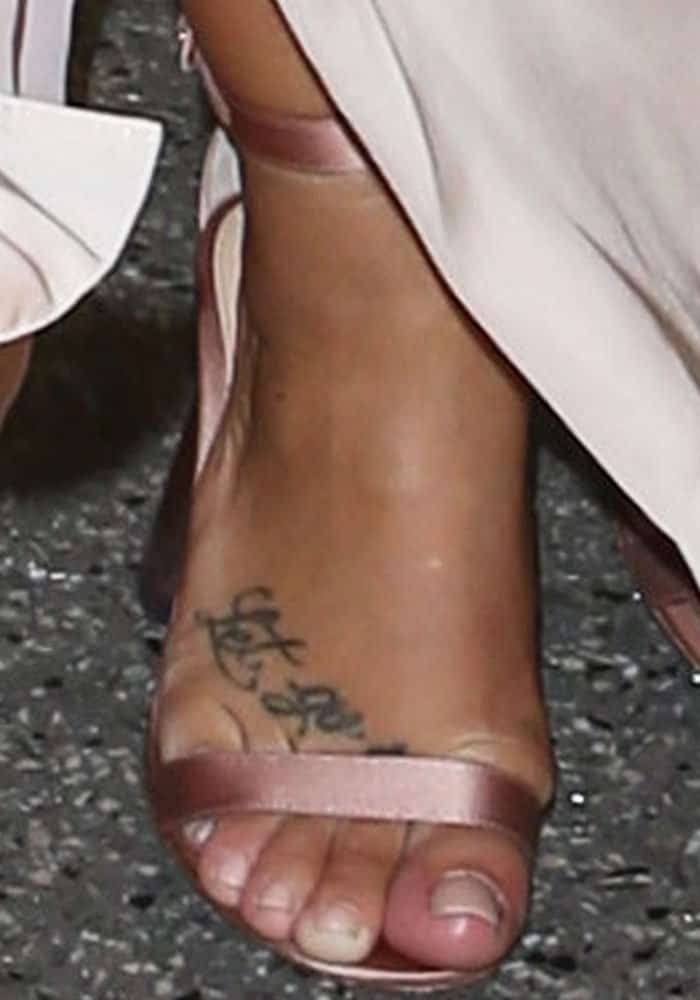 "The singer finishes her look with a pair of satin ""Portofino"" sandals from Gianvito Rossi"