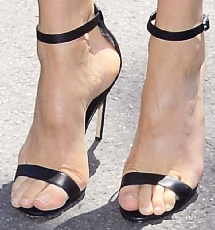 """The model wears the classic Manolo Blahnik """"Chaos"""" sandals"""