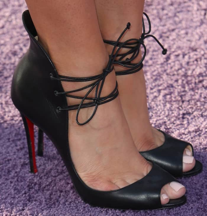 Emily Osment paired her dress with Christian Louboutin Megavamp booties