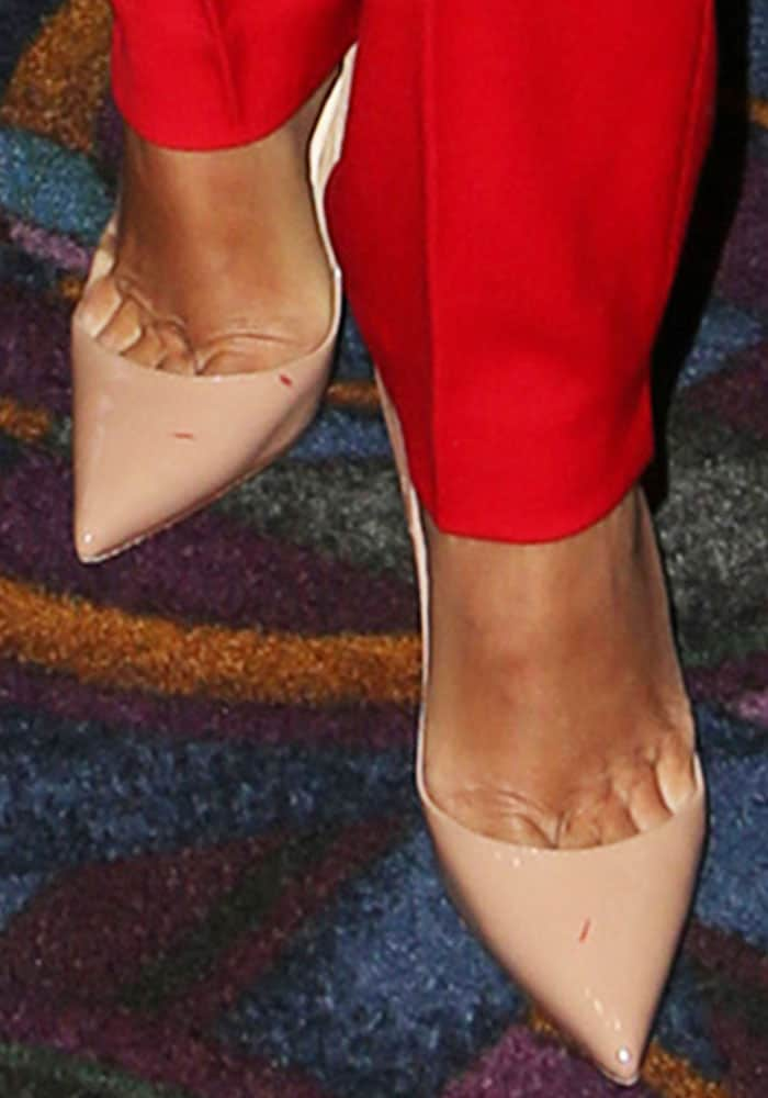 "Eva kept things simple with a pair of Christian Louboutin ""So Kate"" pumps"