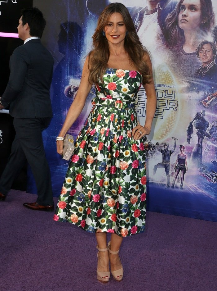 Sofia Vergara's floral dress is crafted in Italy with slender pleats that skim over the hips from under the chunky waist belt, before falling to a flared hem that is lined with white silk