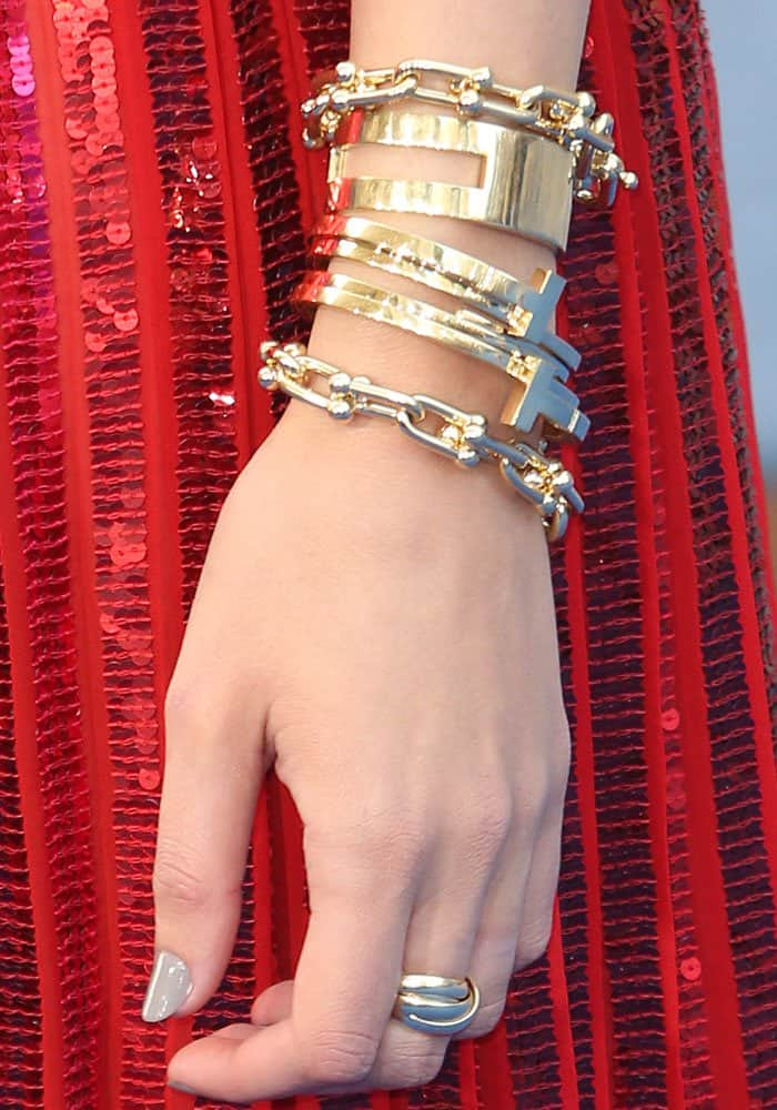 Gal piles on layers of gold jewelry