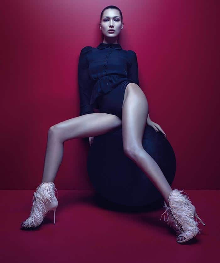 "Bella Hadid in the ""Charleston,"" a lace-front open-toe bootie covered in marabou feathers inspired by 1920s flappers."
