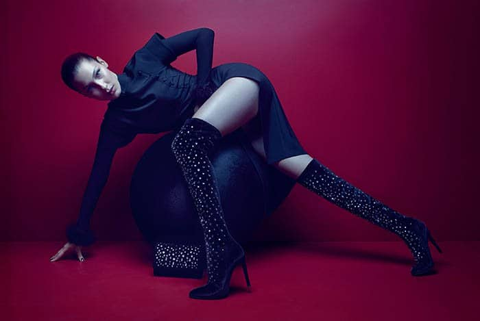 "Bella Hadid modeling the ""Dazzling Dena,"" an over-the-knee boot style made of velvet and embellished with crystals."