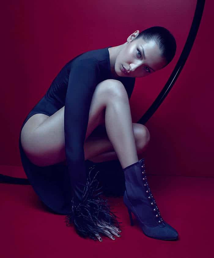 """Bella Hadid striking a pose in Victorian-inspired """"Janice"""" corset lace-up booties in the Giuseppe Zanotti Fall/Winter 2017 ad campaign."""