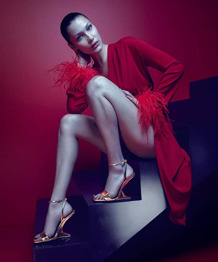 "Bella Hadid wearing the Giuseppe Zanotti ""Picard"" gold ankle-strap sandals with illusion wedge heels as part of the Giuseppe Zanotti Fall/Winter 2017 advertising campaign."