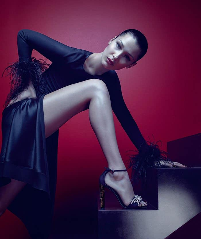 """Bella Hadid modeling the """"Sabine"""" ankle-strap sandals with crystal brooches and leopard fur heels in the Giuseppe Zanotti Fall/Winter 2017 ad campaign."""