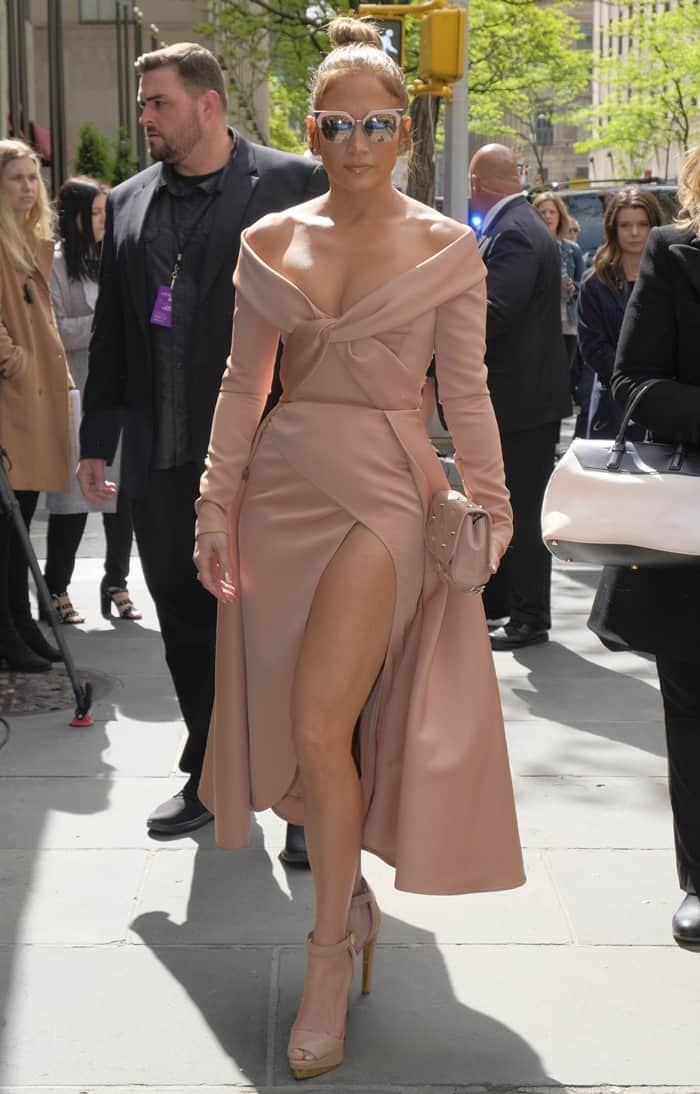 Jennifer Lopezflashed cleavage and a lot of leg in a satin gown from the Elie Saab Spring 2017 Couture collection