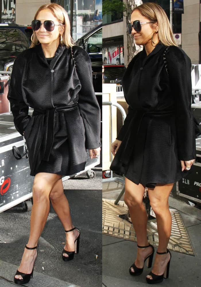 J.Lo wore an all-black ensemble underneath her Max Mara coat