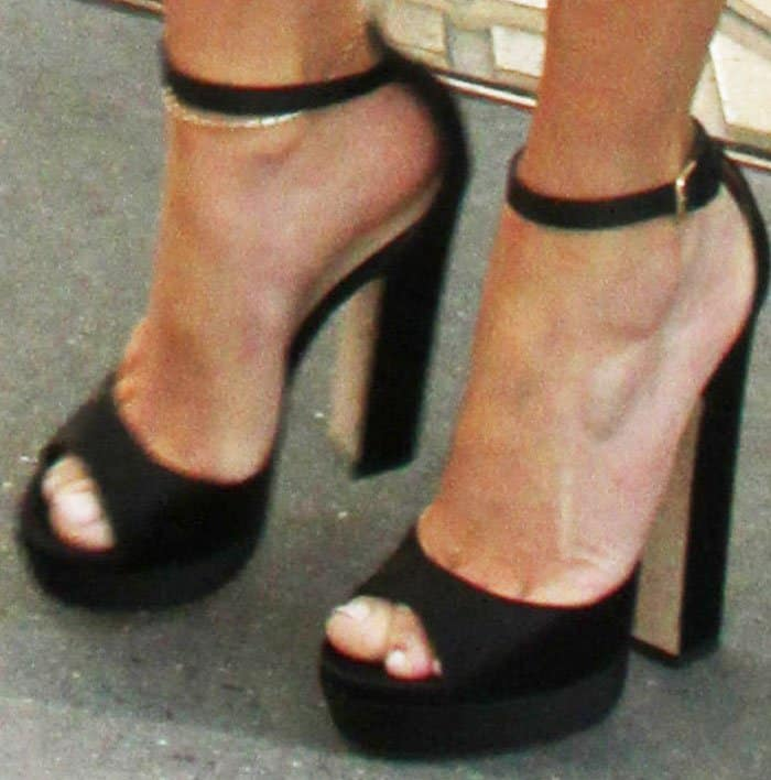 J.Lo wore her first pair of Jimmy Choo platform shoes for the day