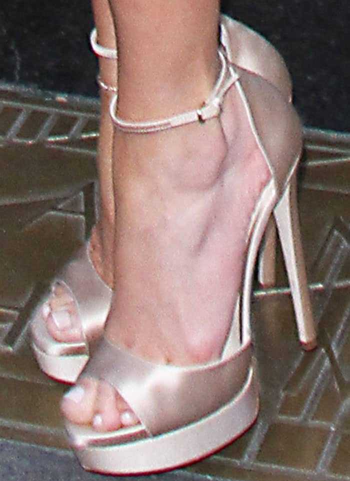 Jennifer slips into her second pair of Jimmy Choo sandals