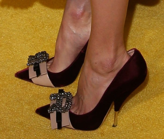 Kate pairs her dress with Rochas bow pumps that are a size too large for her