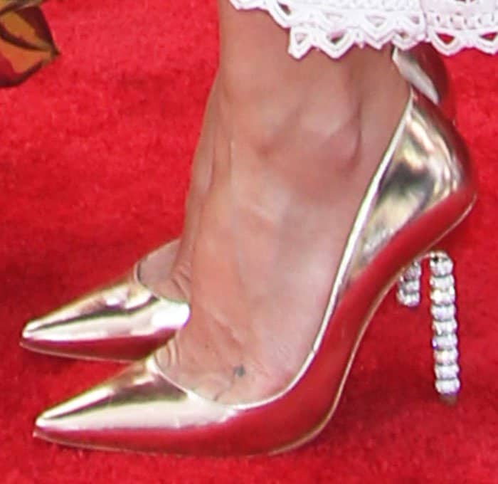 "Kate adds some shine to her look with a pair of Sophia Webster ""Coco Crystal"" pumps"