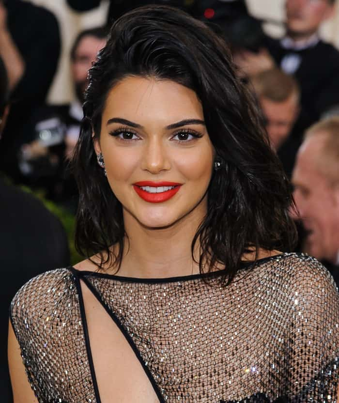 Kendall Jennerstyled the barely-there dress with a painted macramé bodysuit