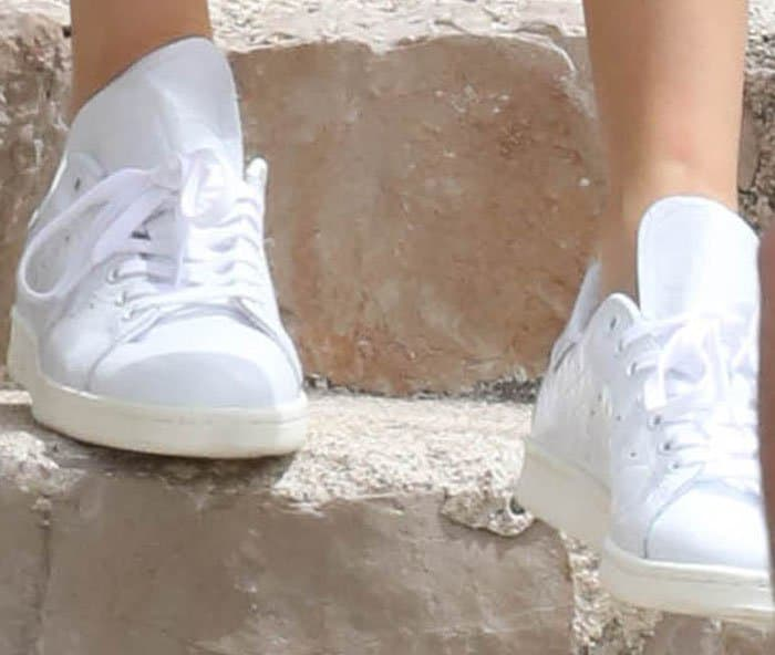 The model roughs up her Adidas 'Stan Smith' sneakers to make them summer-ready