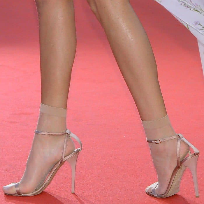 Kendall showing off her feet in Jimmy Choo heels and ugly granny socks