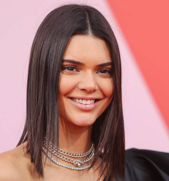Kendall Jenner accessorized with silver layered necklaces