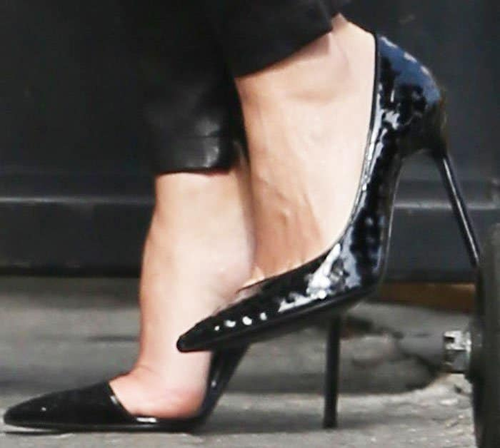 "The actress added an interesting touch to the classic black pumps in an embossed pair of Saint Laurent ""Anja"" pumps"