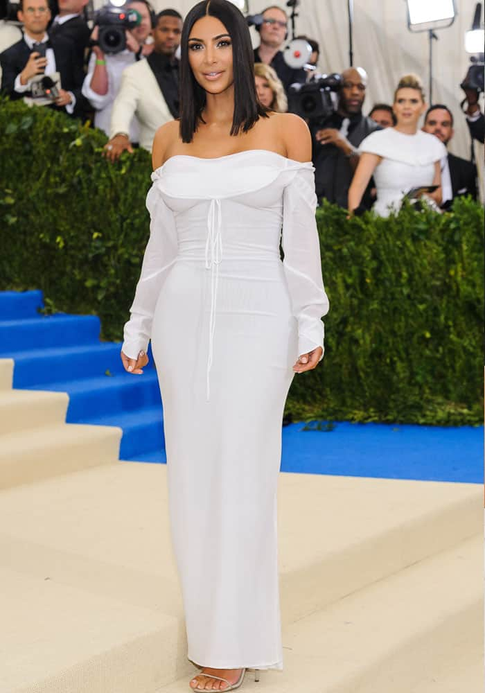 Kim decides to keep things simple this year in an off-shoulder Vivienne Westwood dress