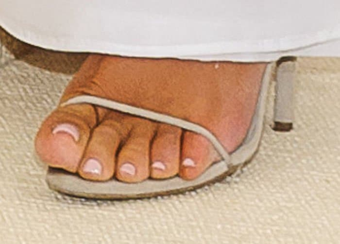 Kim allows a little bit of her Yeezy sandals to peek out