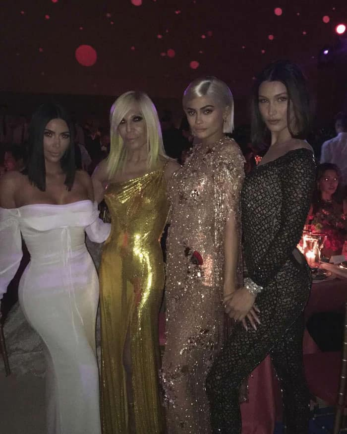 Kim shows off some gorgeous frocks with Donatella Versace, Kylie Jenner and Bella Hadid