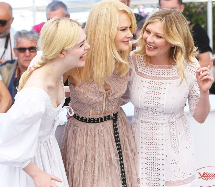 2ff2bd150cb Kirsten shares a hearty laugh with her co-stars Nicole Kidman and Elle  Fanning