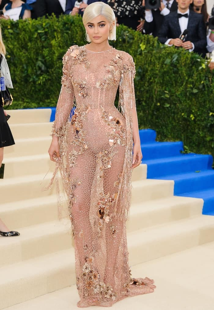 Kylie Jenner bares her body in a sheer custom Versace creation at the MET Gala on May 1, 2017 at the Metropolitan Museum of Art in New York City