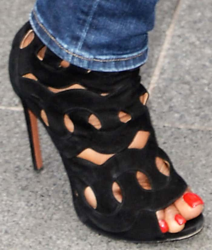Naomi turns to her favorite shoe brand Alaïa for a cute pair of cutout sandals