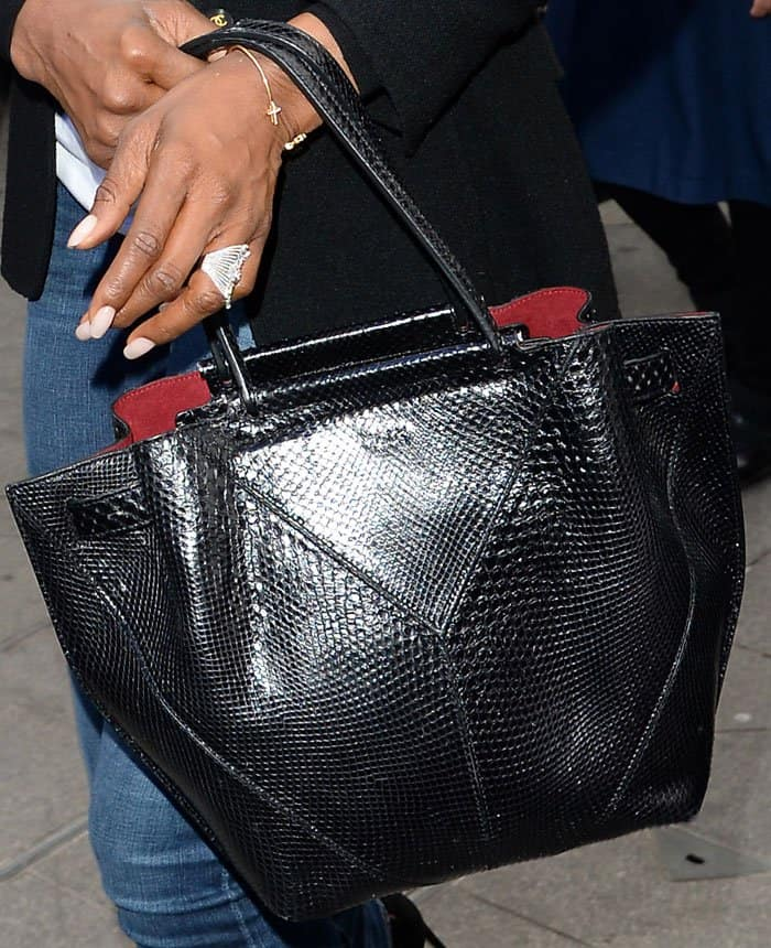 Naomi keeps things chic and casual with a reptile embossed leather tote