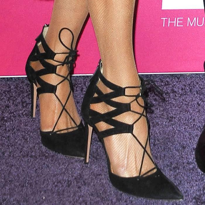 Closeups of Paris Hilton's Aquazzura Belgravia black suede lace-up pumps
