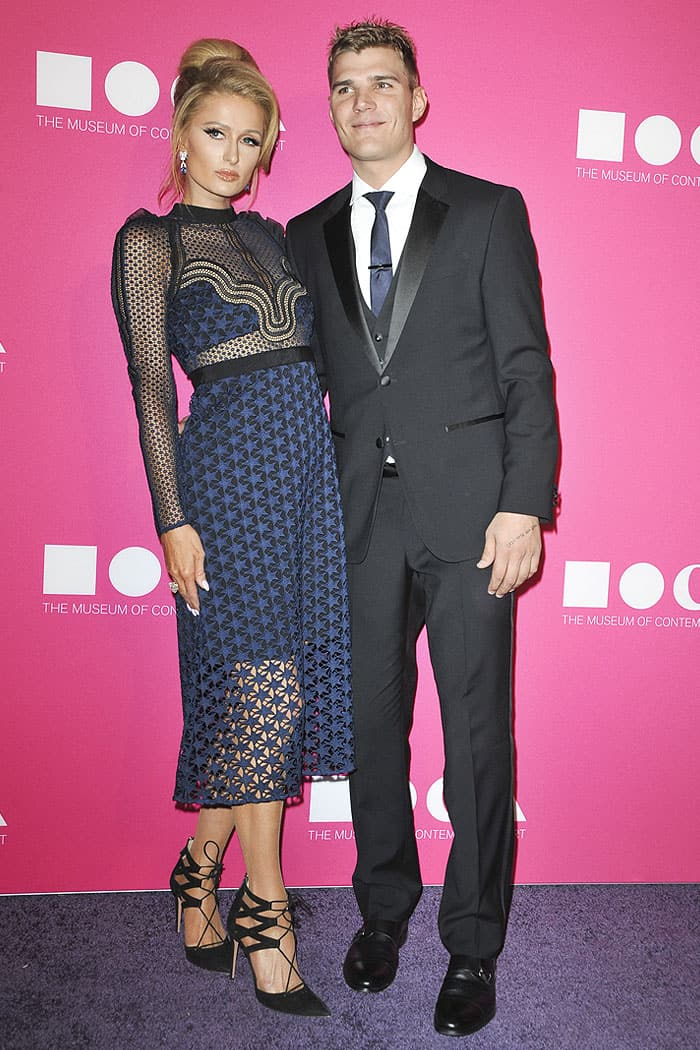 Paris Hilton posing with boyfriend Chris Zylka on the purple carpet at the 2017 MOCA Gala.