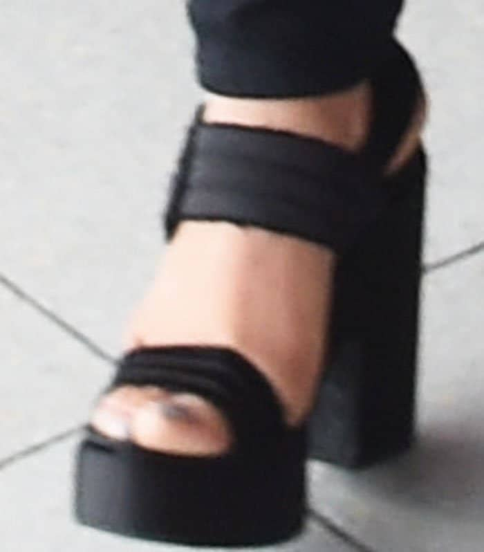 The actress towered in a pair of double strap platform sandals
