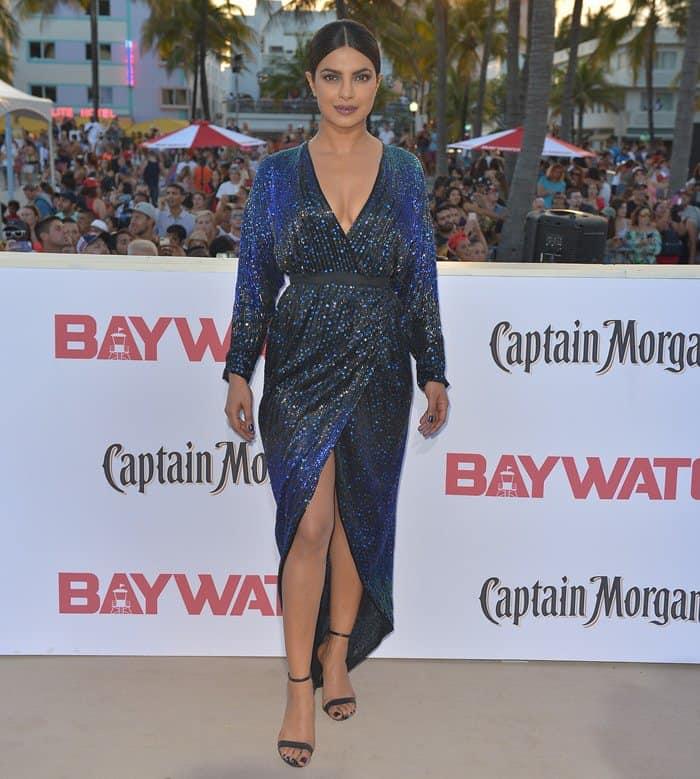 Priyanka Chopra ina blue sequin-embellished long-sleeve dress from Vintage Halston