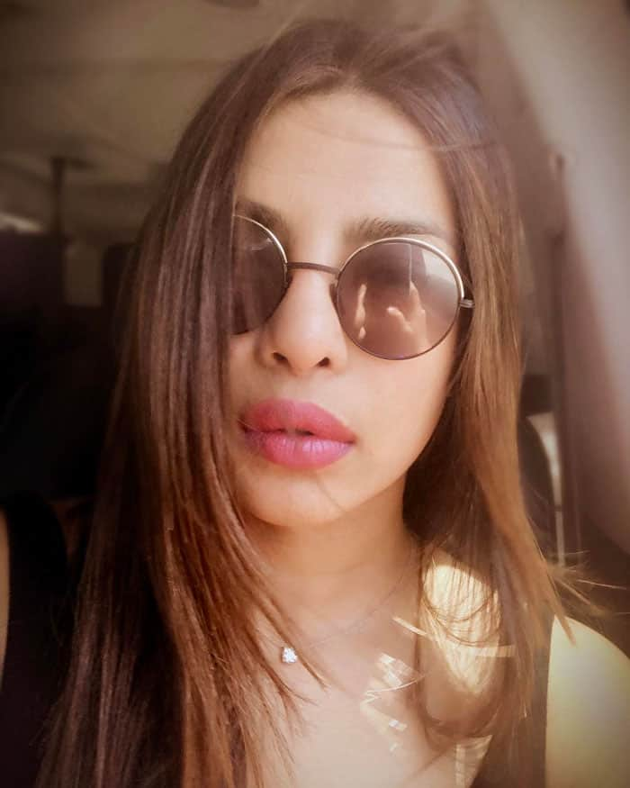"Priyanka takes her first selfie in the car to LAX captioned, ""Berlin bound but selfie first. #summertimefeels"""