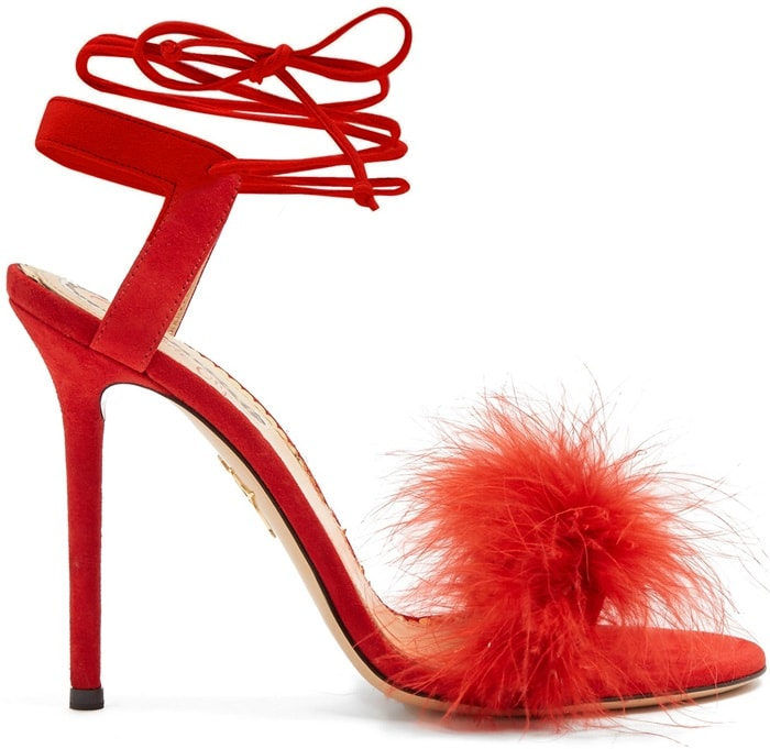 These red sandals are crafted in Italy with sumptuous ostrich feather-covered front straps and alluring ties that wrap around the ankles