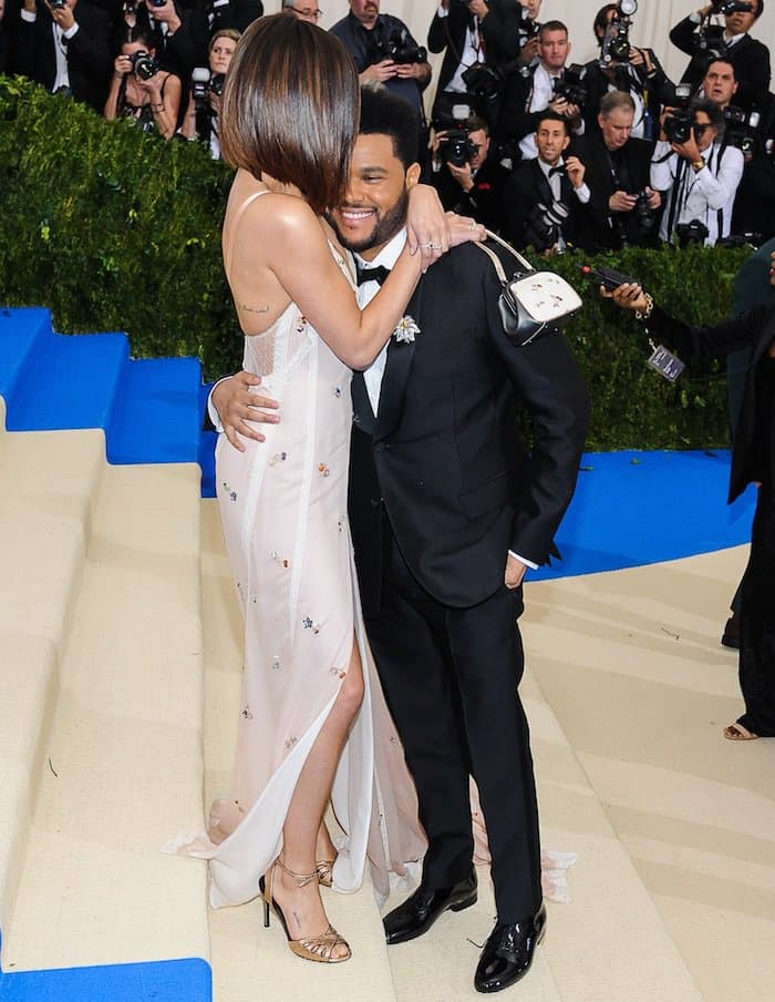 Selena Gomez showers The Weeknd with affection in a custom Coach gown for the MET Gala on May 1, 2017 at the Metropolitan Museum of Art in New York City
