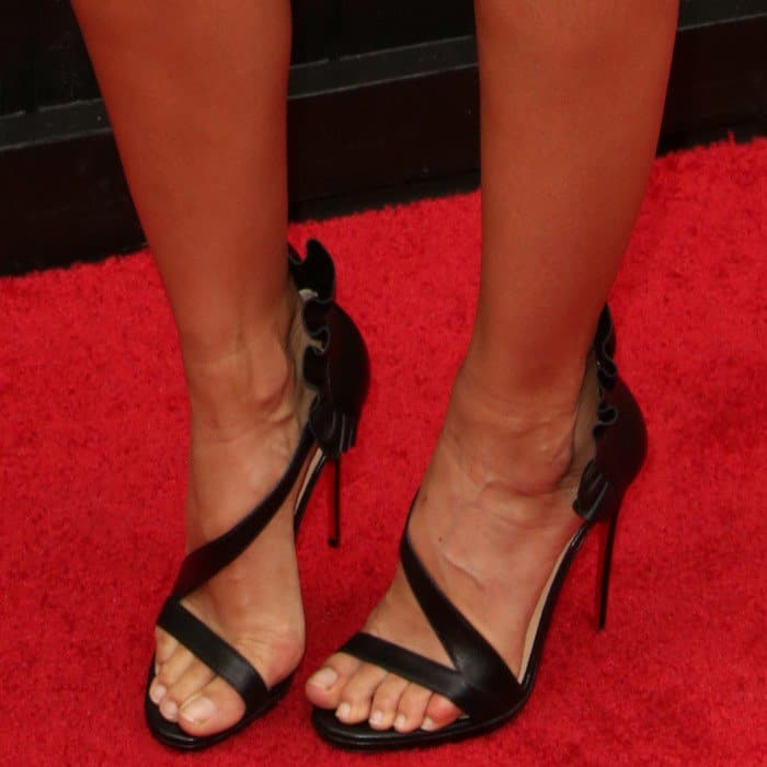 Stephanie Sigman wearing black patent leather Christian Louboutin 'Colankle' sandals
