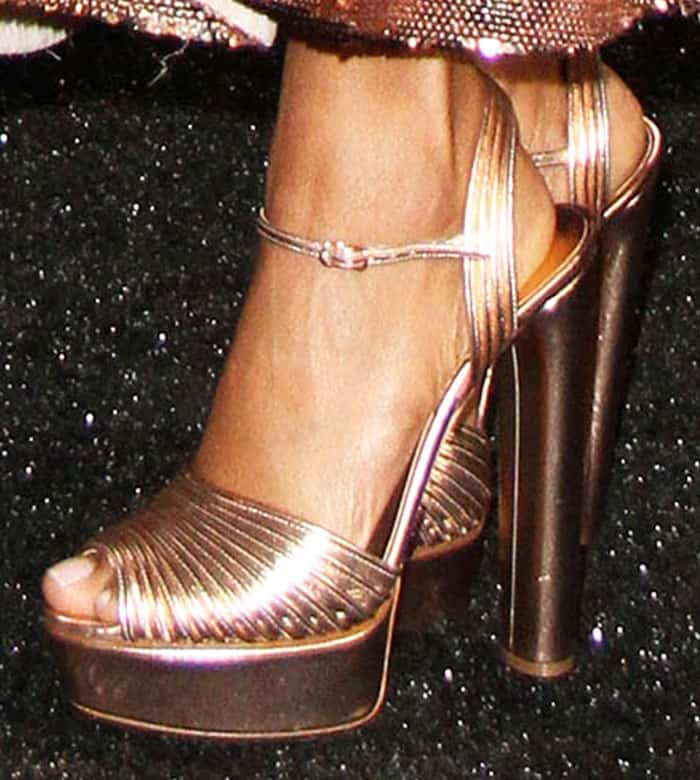 Taraji paired her dress with a pair of quilted metallic platform sandals by Casadei