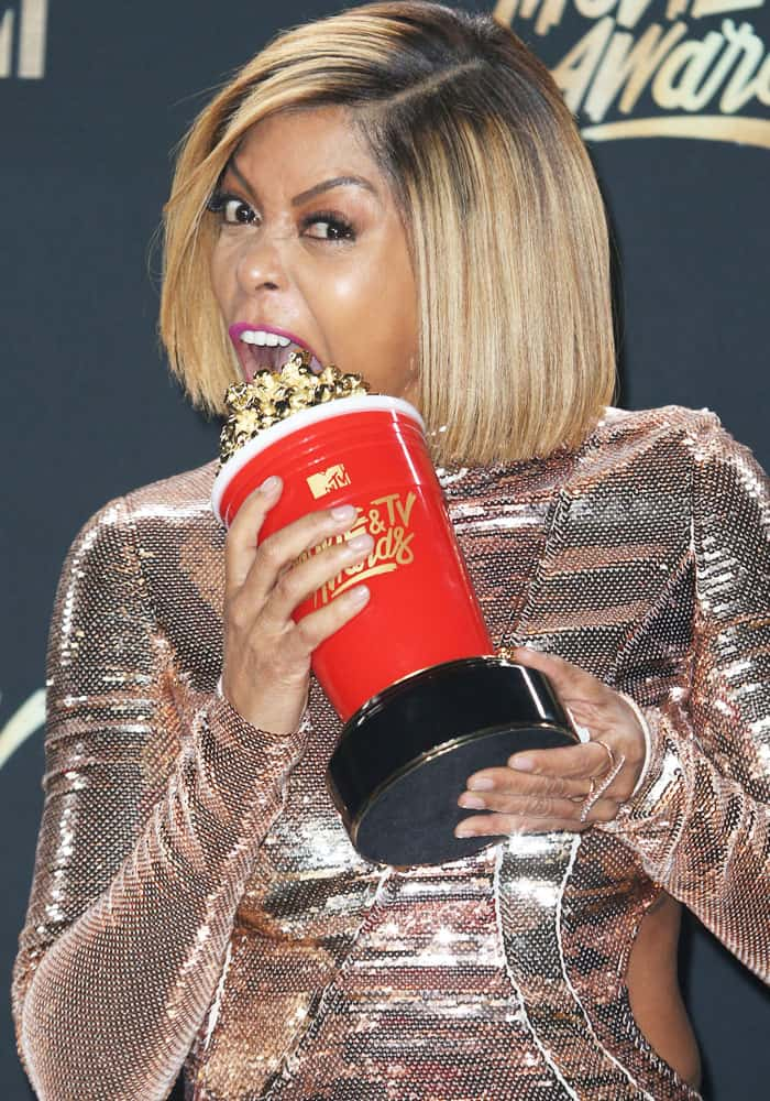 "Taraji bites into her popcorn award for ""Best Fight Against the System"""