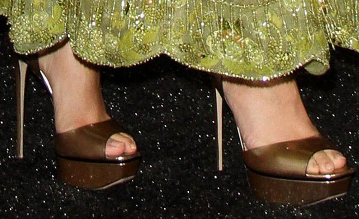 Zendaya adds a little shine to her look with a pair of metallic platforms from Le Silla
