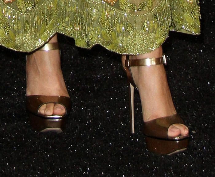 Zendaya paired her dress with bronze platform sandals from Le Silla