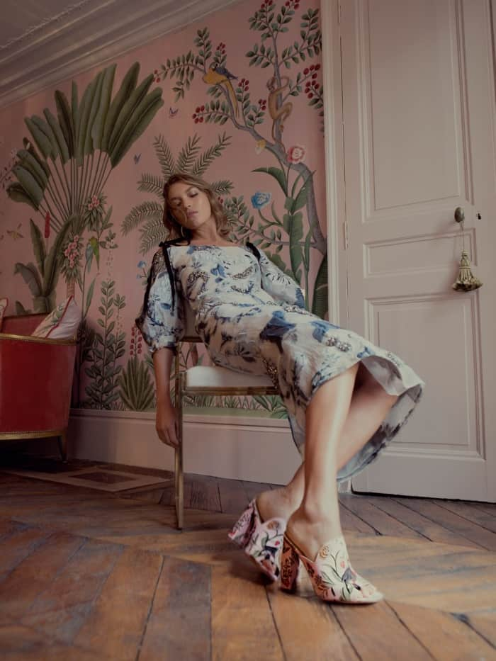 "Arizona Muse wearing the Aquazzura for de Gournay embroidered mules with Erdem's ""Bree"" floral fil coupe dress"