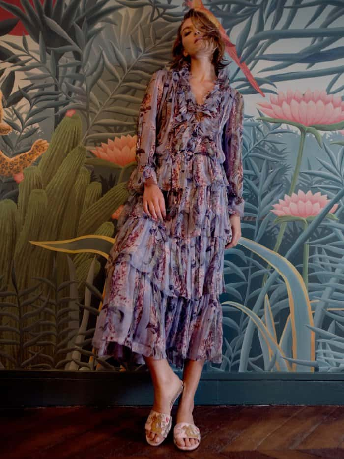 Arizona Muse wearing the Aquazzura for de Gournay embroidered slides with Zimmermann's floral-print silk-georgette blouse and matching skirt