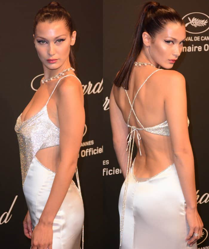 Bella Hadid wearing a Roberto Cavalli couture gown and Rene Caovilla silver snake sandals at the Chopard Space Party