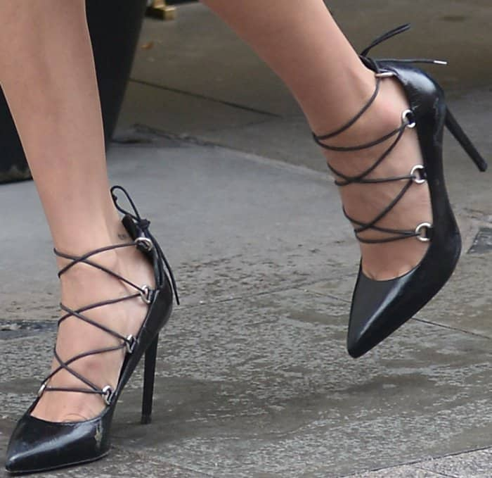 """Bella Hadid wearing a Chrome Hearts x Bella look styled with Saint Laurent """"Paris"""" lace-up pumps in London"""